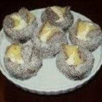 Lamington Fairy Cakes A traditional Australian cake, lamingtons are well loved here in Oz. Delicious moist white cake dipped in chocolate and then in coconut....