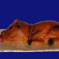 Roasted Pig Pig is carved from red velvet cake and iced with cream cheese frosting. I then airbrushed him various shades of brown, yellow and black and...