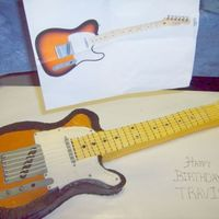 Fender Guitar vanilla cake exact replica of my boss's birthday present. he loved the cake AND his birthday present!! Almost didnt eat the cake!!...