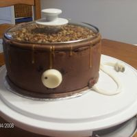 Set It And Forget It, Crock Pot Cake 3 layers round cake, made cord out of fondant and candy melt knob. Used my own real lid from a crock pot to disguise this cake, everyone...