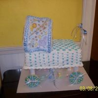 Baby Carriage Baby Carriage cake, basket weave cake, cookie wheels, bonnet is made of fabric and ribbon