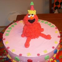 Elmo's Birthday Elmo sitting on the birthday cake ready to party. Elmo's body is a mini-wonder mold, fondant head, and snipped a corner off of a sugar...