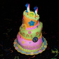 Groovy Topsy Turvy Topsy Turvy for 60's Birthday. Buttercream with fondant accents. Hope you like.:)