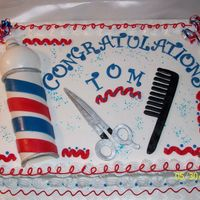 Barber Retirement Barber pole made from gumpaste as well as the scissors & comb.