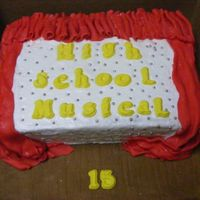 High School Musical Cake   vanilla butter cake with white chocolate butter cream filled and iced. Fondirific fondant drapes, letters and board covered.