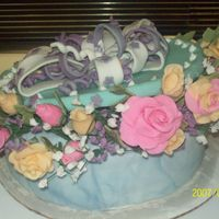 Gift Box Cake I am trying to remind myself this is only your forth cake, This cake did not turn out as planned, However I am very happy with the flowers...