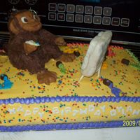 Monkey Painting  THis is a crazy vanilla cake with cotton candy flavored icing, the Monkey is made out of Rice Krispies and covered in modeling chocolate....