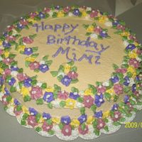 Mimi's Birthday   This is a white chocolate almond sourcream cake with white chocolate buttercream and RI Flowers