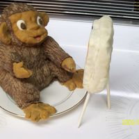 Painting Monkey this is a rice krispy moneky and easel covered in modeling chocolate