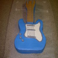 Guitar Cake This was my first guitar cake. I just used a 9x13 pan & shaped my guitar. Cake was chocolate covered in buttercream w/fondant accents...