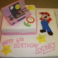 Mario Birthday Cake Made for 6 yr. old girl who has a Pink Nintendo DS & loves Mario. Cake is White Almond Sour Cream with fondant accents.