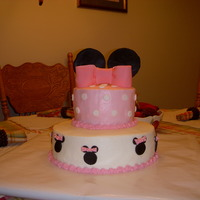 Minnie Mouse Cake Chocolate cake with homemade buttercream & fondant accents.