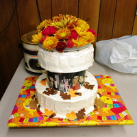 Fall Birthday Cake Carrot cake on top & chocolate on bottom, both with cream cheese icing, fondant leaves & candy corn.