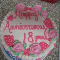 Mom And Dad's Anniversary Cake  This is my first cake ever!!! It is a vanilla bean cake with cherry filling and wilton vanilla whipped cream icing. All the decorations and...