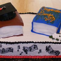 Book Grad Cake This is a double layer 1/2 sheet cake w/ 2 books. My first attempt at making the books.