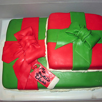 Christmas Gifts This was done for my youngest son's class Christmas party. Both strawberry cake with real buttercream filling. Covered in mmf.