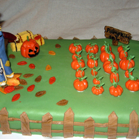 Harvest Party Cake This was done for my youngest's 5th grade class for Harvest festival. Dark chocolate fudge cake with buttercream filling. Covered in...