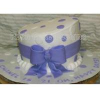 Single Tier Topsy Turvey   Buttercream iced with fondant accents.Thanks for looking