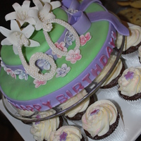 "Mom's 60Th Birthday Cake  Cake & matching cupcakes for my mom's 60th birthday. Gumpaste lillies & flowers, gumpaste ""60"" cake topper, and..."