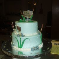 Gone Fishin' buttercream and fondant accents. thanks for looking, this really was a last minute cake. i had it frosted blue and still couldn't come...