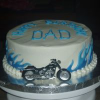 Blue Flames last minute birthday cake, buttercream with fondant flames. didnt have time to make motorcycle, so it is a scrapbook bike on a toothpic