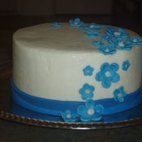 Blue Flowers buttercream with fondant ribbon and flowers 6""