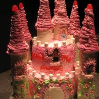 First Castle Cake  i was pround of it and i had difficulties to do it because the icing stick to the impress matt and when i arrived at destination, the...
