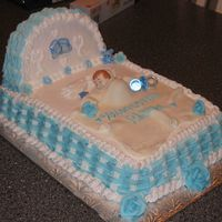 Crib   this was for sale. the blanket was with fondant MMF with Ronda andthe cake was cover with buttercream icing.