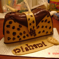 Animal Print Handbag Cake my first purse cake and first time carving a cake.made for a good friend who loves anything African - she loved it.