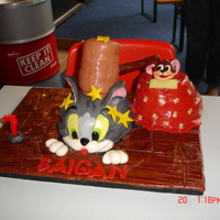 Tom And Jerry Cake a bit embarrassed about this cake - felt it was quite untidy. inspired by a Debbie Brown design. still have lots to learn about sculpting,...