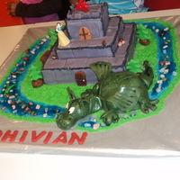 Dragon Castle Cake my 4 year old was very specific in his requirements: purple castle made of blocks, trees and bench around castle, fat green dragon,...