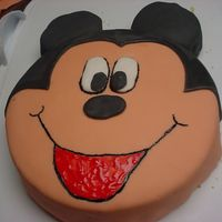 Mickey This was for my sons 2nd birthday. this was my 1st mickey cake. All is done in fondant except for the red in the mouth and the black...