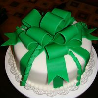 Green Present I made this for St. Patrick's Day, it's a white cake dyed green, covered in white fondant with green fondant bow and stripes. I...