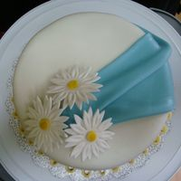 Swag And Daisies I made this cake for my grandparents anniversary, swag and base are MMF, daisies are made out of gum paste.