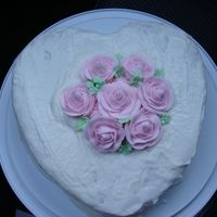"Heart Cake With Royal Icing Roses This is a 10"" heart cake pan, I used the Magnolia Bakery icing for this cake which is quite sweet and a bit runny. I made the roses..."