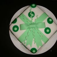 "Green Circle Fondant Cake This is an 8""x8"" square pan covered in white fondant and then used circle cutters to make an inlayed design."