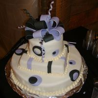 "Black And Purple Polka Dot Cake I donated this cake to a non-profit org in NYC. It's a 14"" round as the base, 8"" square middle, and 6"" round as the top..."