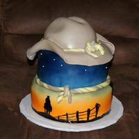 Cowboy Silhouette At Sunset There are 3 different hand painted cowboy silhouettes on this cake.