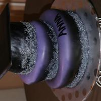 Purple, Silver, And Black Topsy Turvy! Topsy turvy cake made for a graduation student.