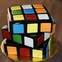 Rubik's Cube Cake 8 inch marble cakes carved down on the side to make the edges sharper. This was for my son and a LOT of fun to make!!