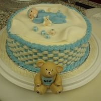Ben's Baby Shower Cake For a friend, yellow cake with buttercream. The blankie is fondant, the baby and bear and toys are 50/50 gumpaste and fondant.
