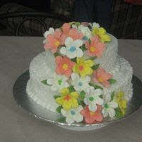 My First Wedding Cake  This is a pina colada cake with a crushed pineapple filling. The flowers are 23 RI petunias in all. icing is buttercream. I want to that...