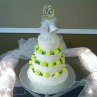 50Th Wedding Anniversary   4 tier pina colada cake for a 50th wedding anniversary. All B/C icing with yellow roses.