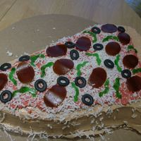 Pizza Cake Pizza cake made with fondant, buttercream and fruit rollups.Two layer cake filled with lemon buttercream