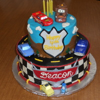 Cars Theme Birthday One layer devils food, one layer vanilla. Covered in b/c with mmf accents.