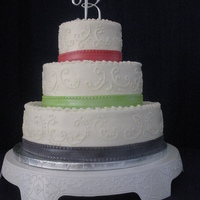 Simple Wedding Cake This cake is covered and decorated in buttercream icing. The different colored ribbon is made from rolled fondant