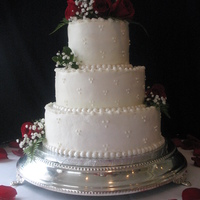Wedding Cake This cake was covered with buttercream icing with fresh red roses added