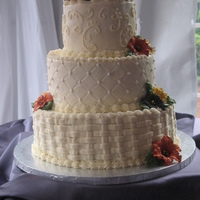 Fall Wedding This cake is covered in buttercream. The lilly flowers are made from royal icing.