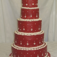 Red Wedding Cake This cake was covered in red buttercream with white accents