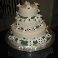 "Mamma's Dogwood Cake  This is a 3 tier (12"", 8"" and 6"") white cake with bavarian cream filling on largest, lemon in middle and pineapple on top..."